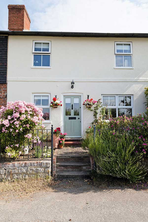 traditional cottage planting adds charm to country home
