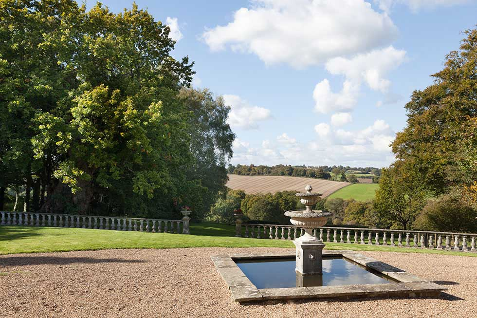 countrside views and gravel pathways around a grand country house