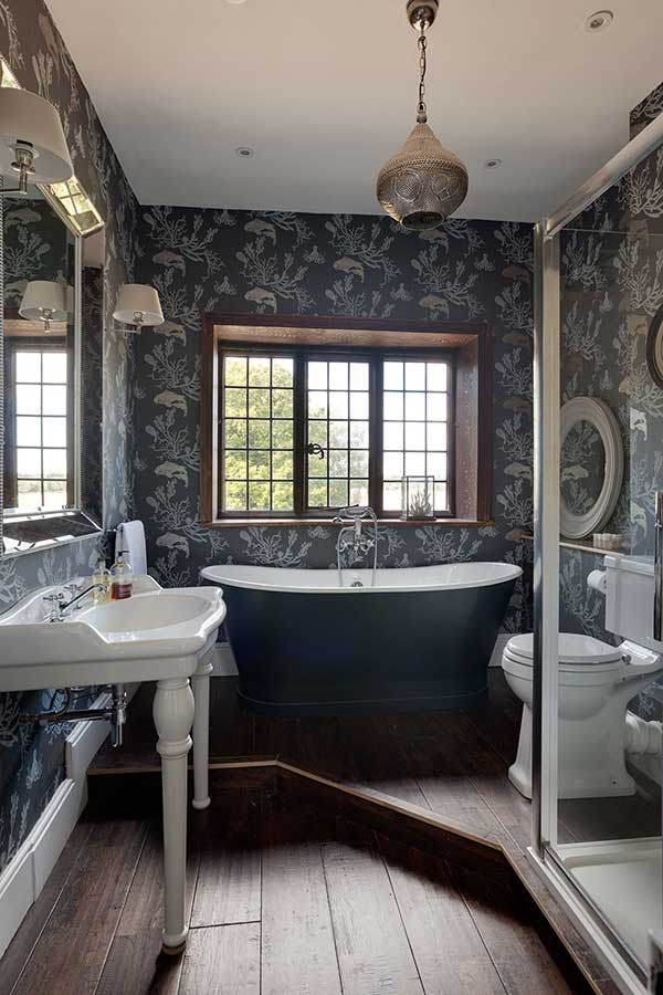Sultry Moody Bathroom With A Raised Roll Top Bath