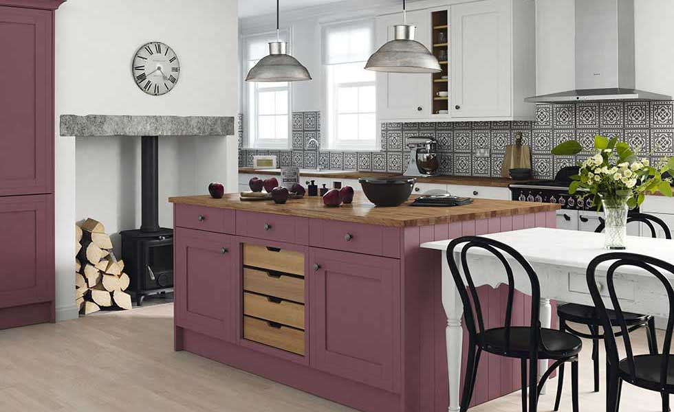 purple island kitchen with black and white tiles and stainless steel kitchen aid
