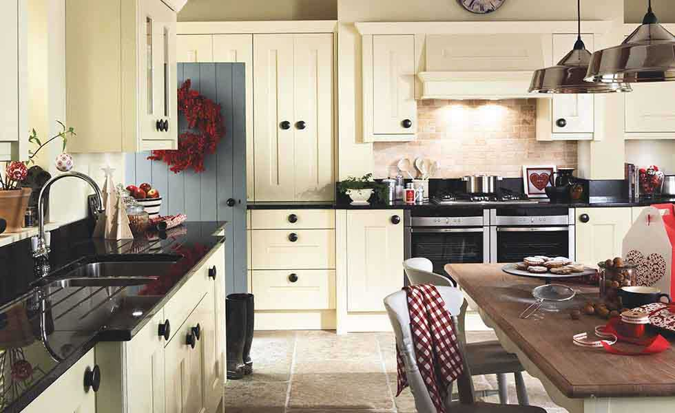 white units kitchen with red accessories