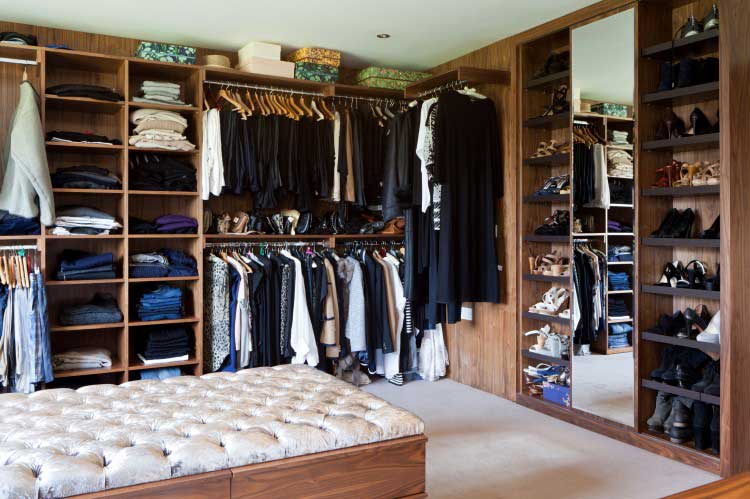 fitted wardrobes in a closet with a mixture of hanging space and shelving