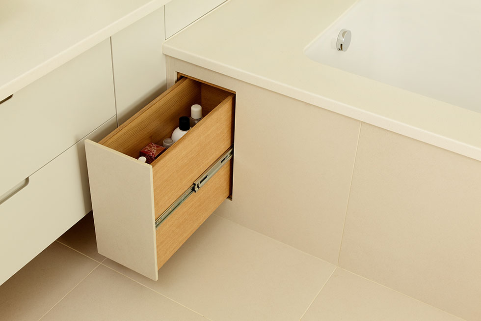 create storage beneath the bath pull out niche under bath cue co