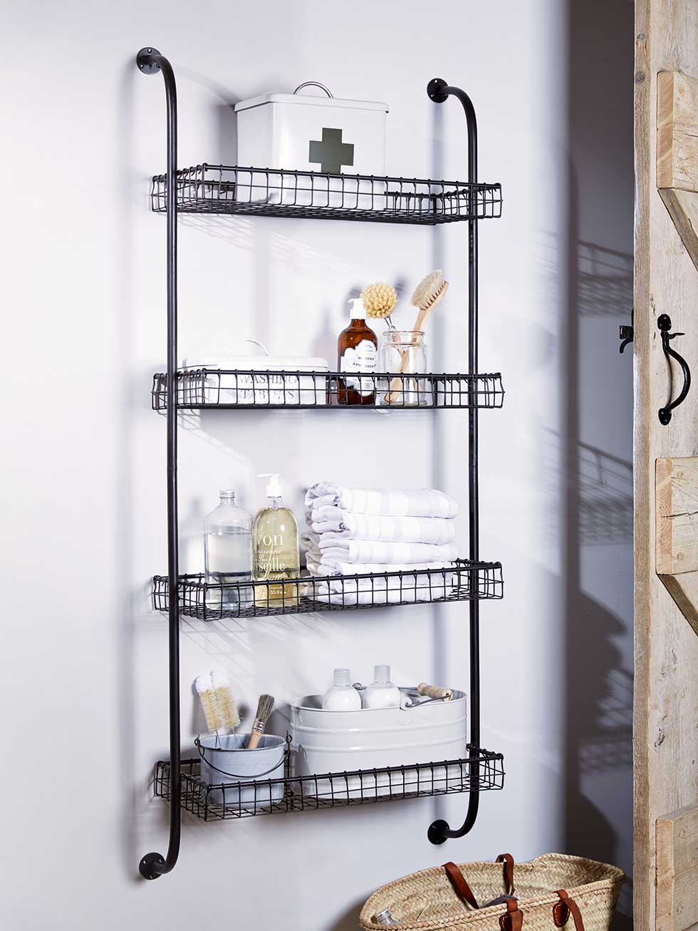 Great bathroom storage ideas real homes for Metal bathroom shelving unit