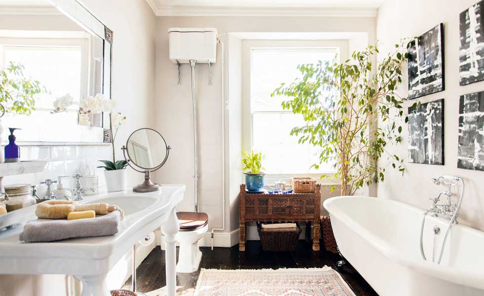 bathroom with white walls and features and antique furniture