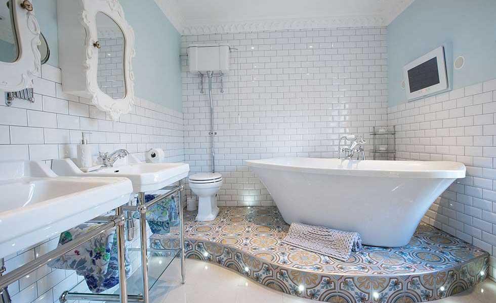 vintage style bathroom with plinth under freestanding bath