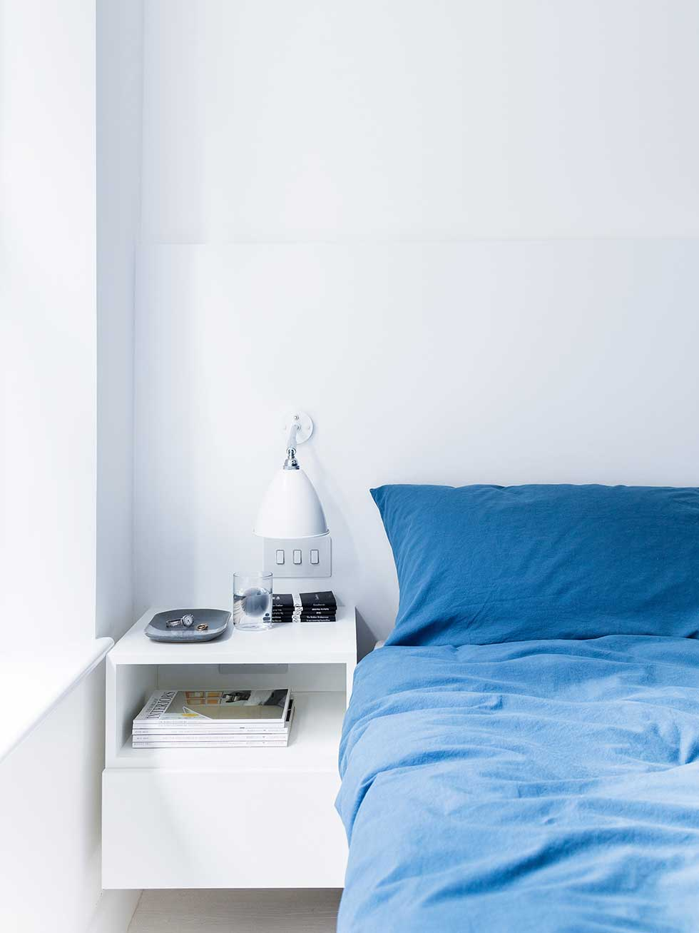 london flat white bedroom blue bedding bedside table