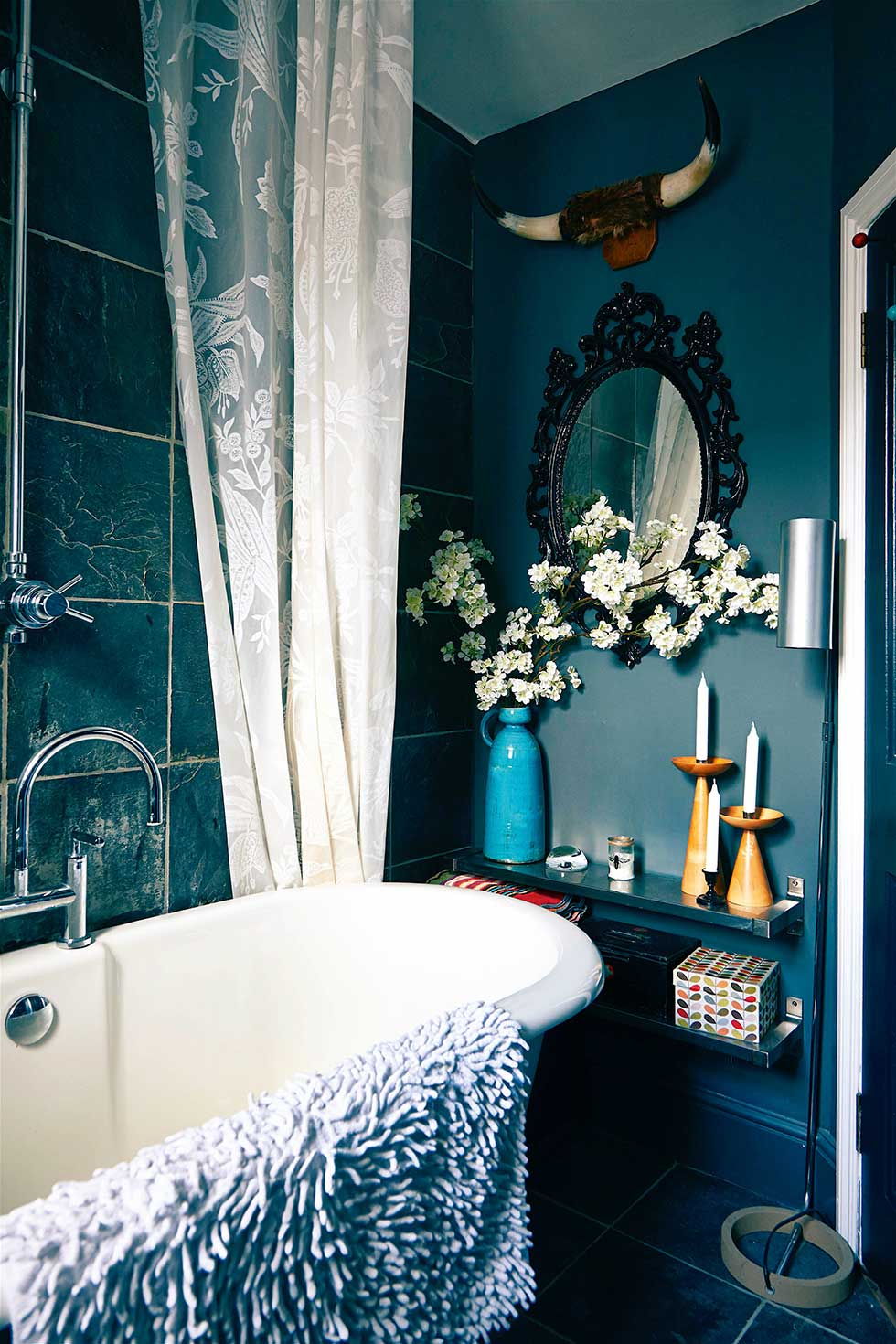 Duplex apartment roll top bath in dark bathroom