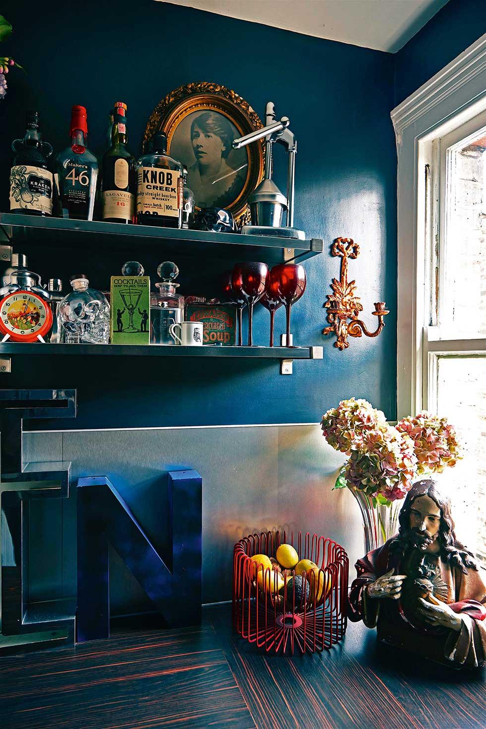 Duplex apartment kitchen shelves and bottles
