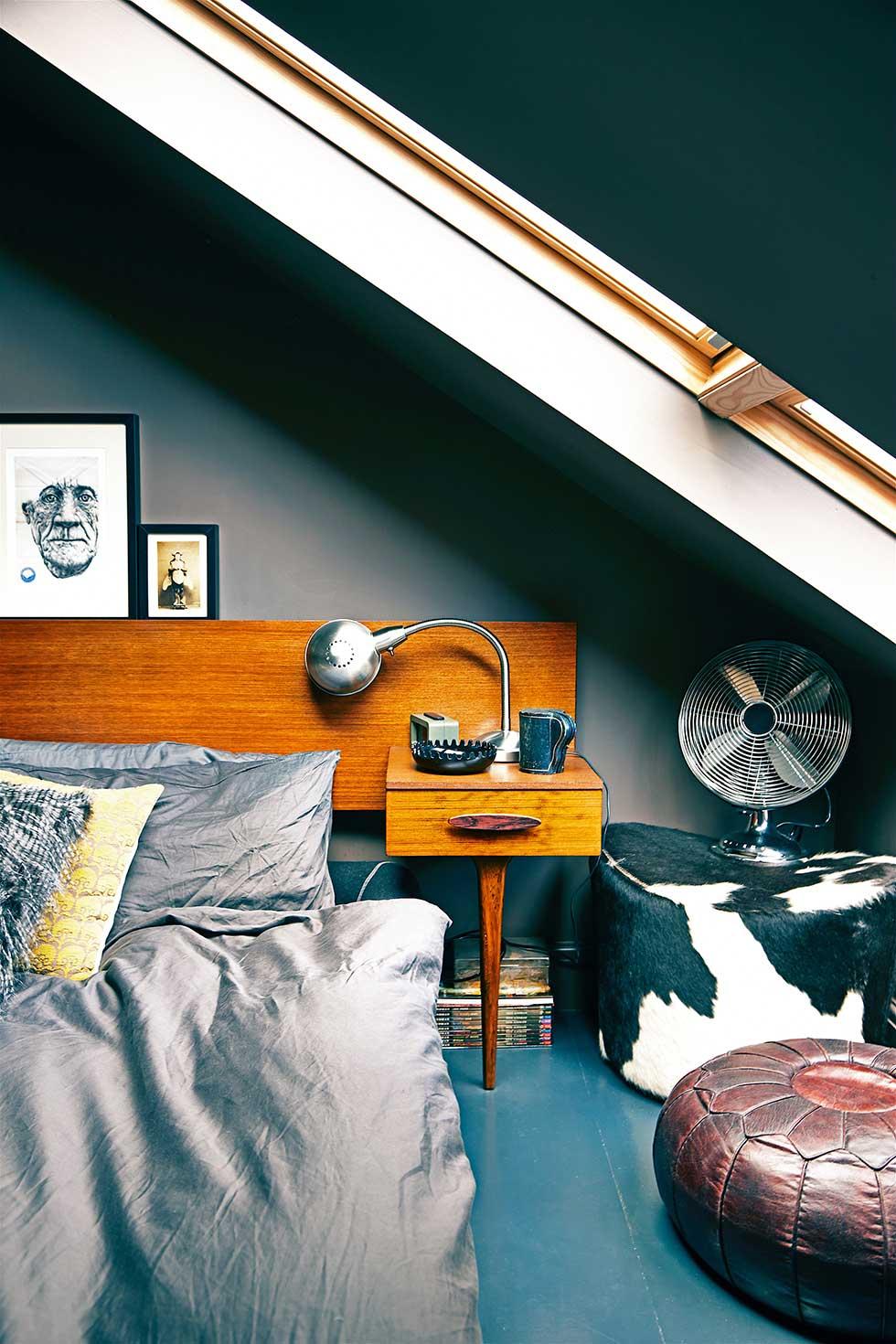 Duplex apartment mid-century bed in dark bedroom