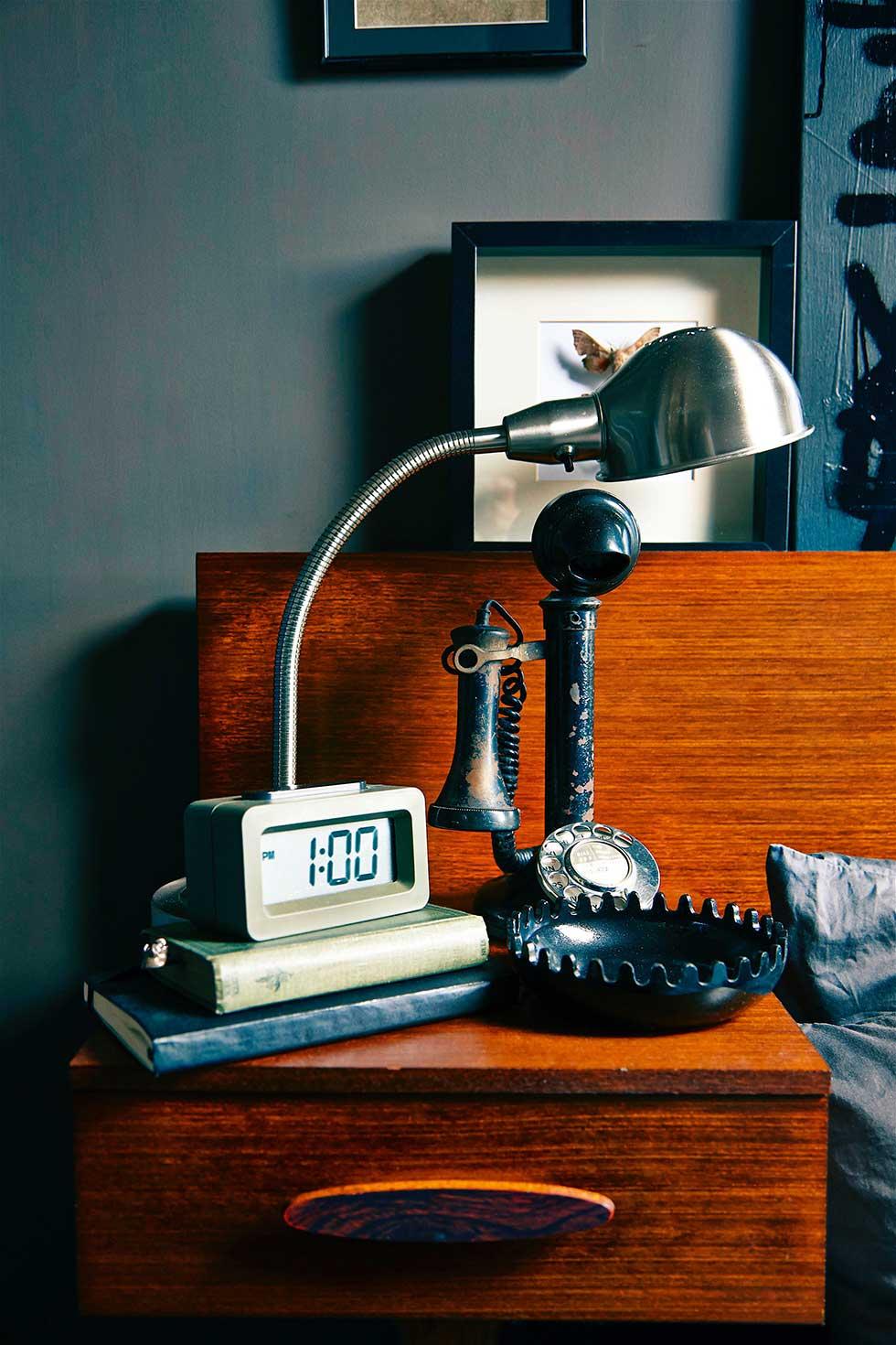 Duplex apartment mid-century bedaide table in dark bedroom