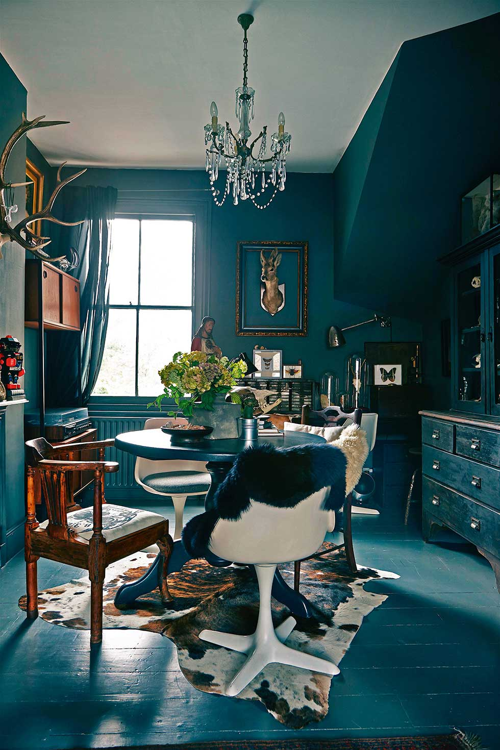 Duplex apartment dark blue dining room