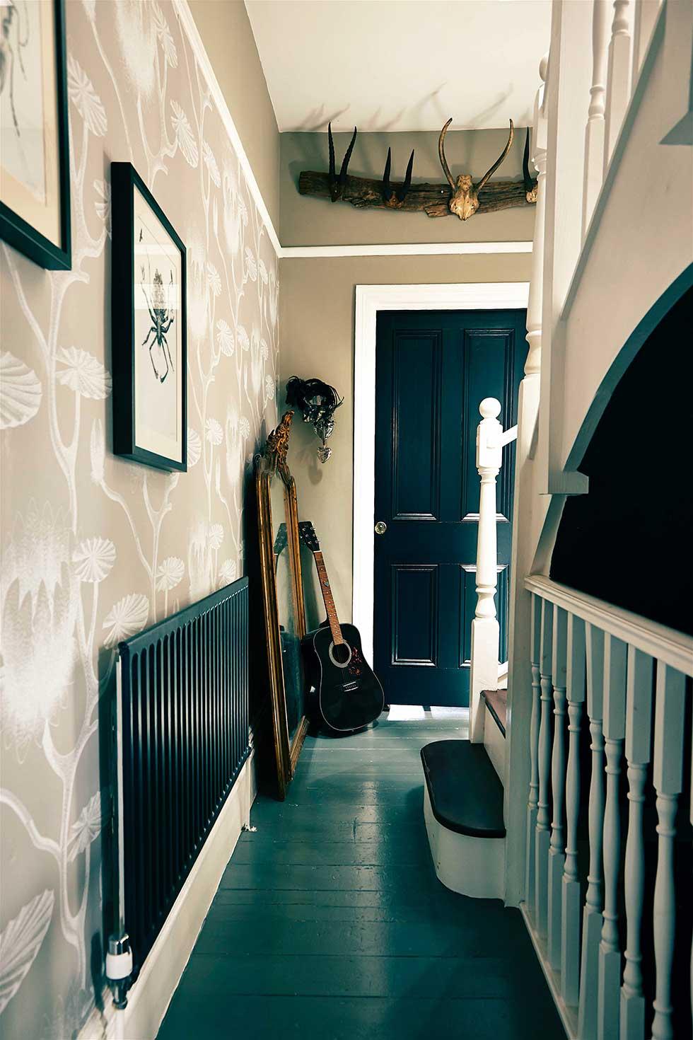 Duplex apartment floral wallpaper in hallway