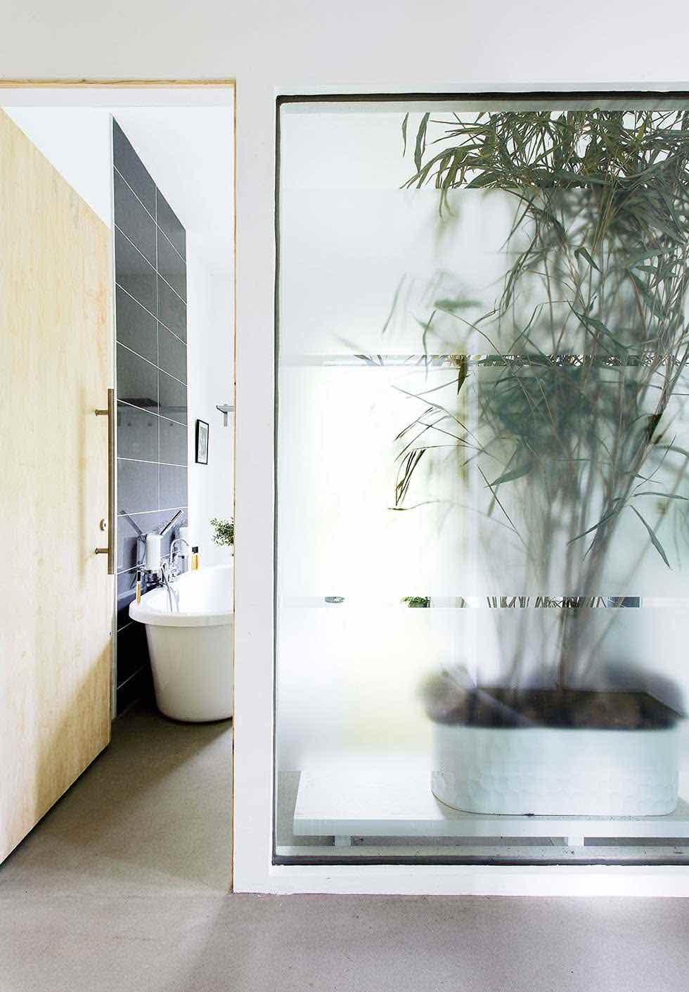 Contemporary conversion of a stone barn real homes for Barn conversion bathroom ideas