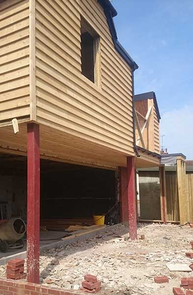 cedar cladding on a extension on stilts