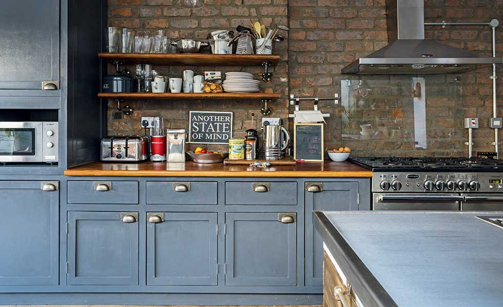anthracite grey kitchen cabinets with exposed brick wall and open shelving