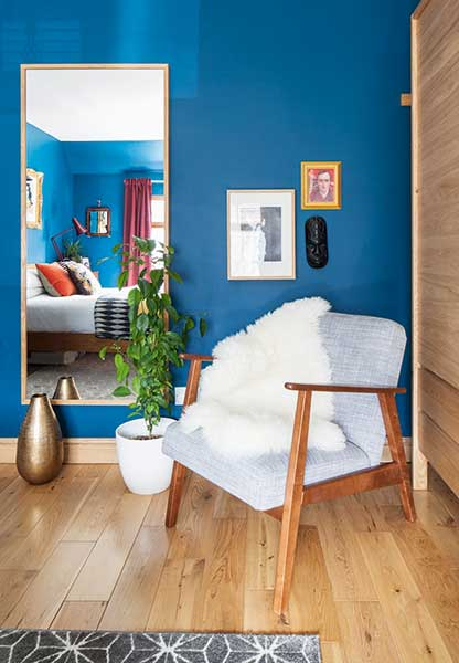 Ekenaset armchair and hovet mirror from Ikea in blue bedroom