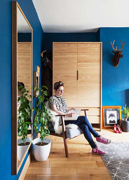 Karen Knox sitting in her blue bedroom in Ekenaset arm chair