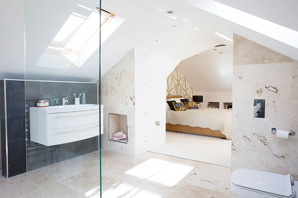 open plan bathroom with travetine flooring