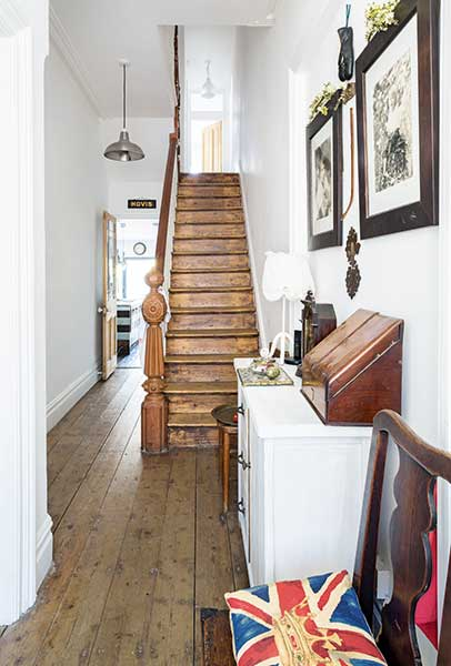 White hallway in Victorian Terrace with original wooden stairs