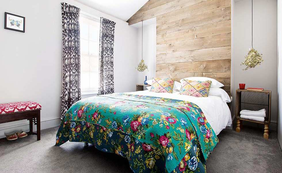 eclectic master bedroom with pattern and bare wood