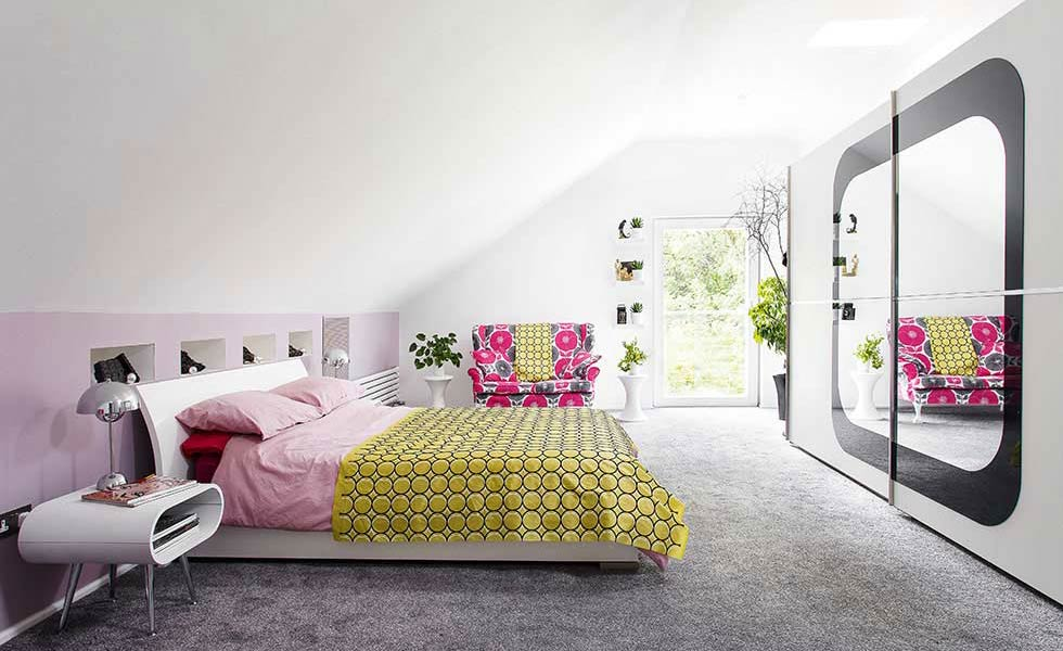 pink bedroom with a feature mirror