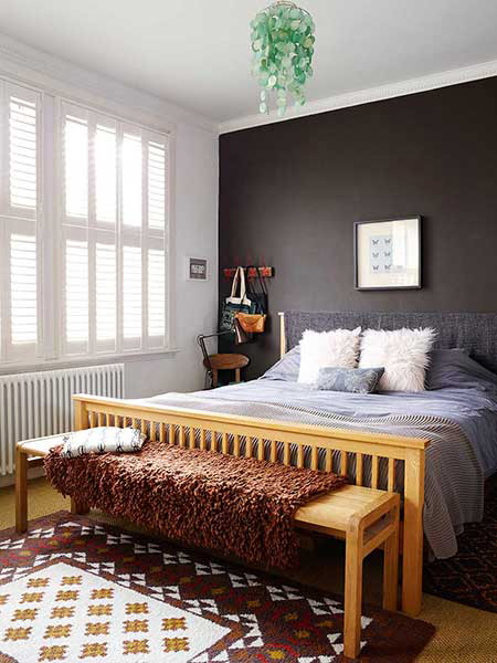stylish family bedroom with a charcole feature wall