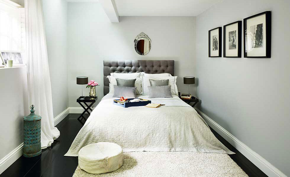 luxury quilted grey headboard in a master bedroom