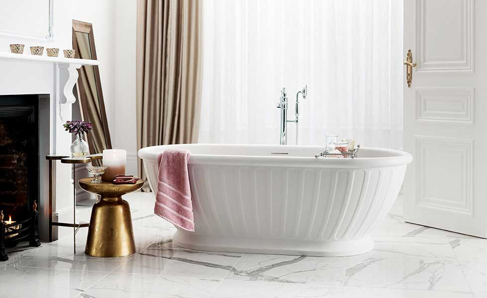 elegant free standing bath in bathroom with marble floor and fireplace