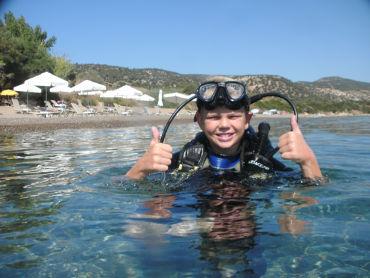 kid diver in sea level