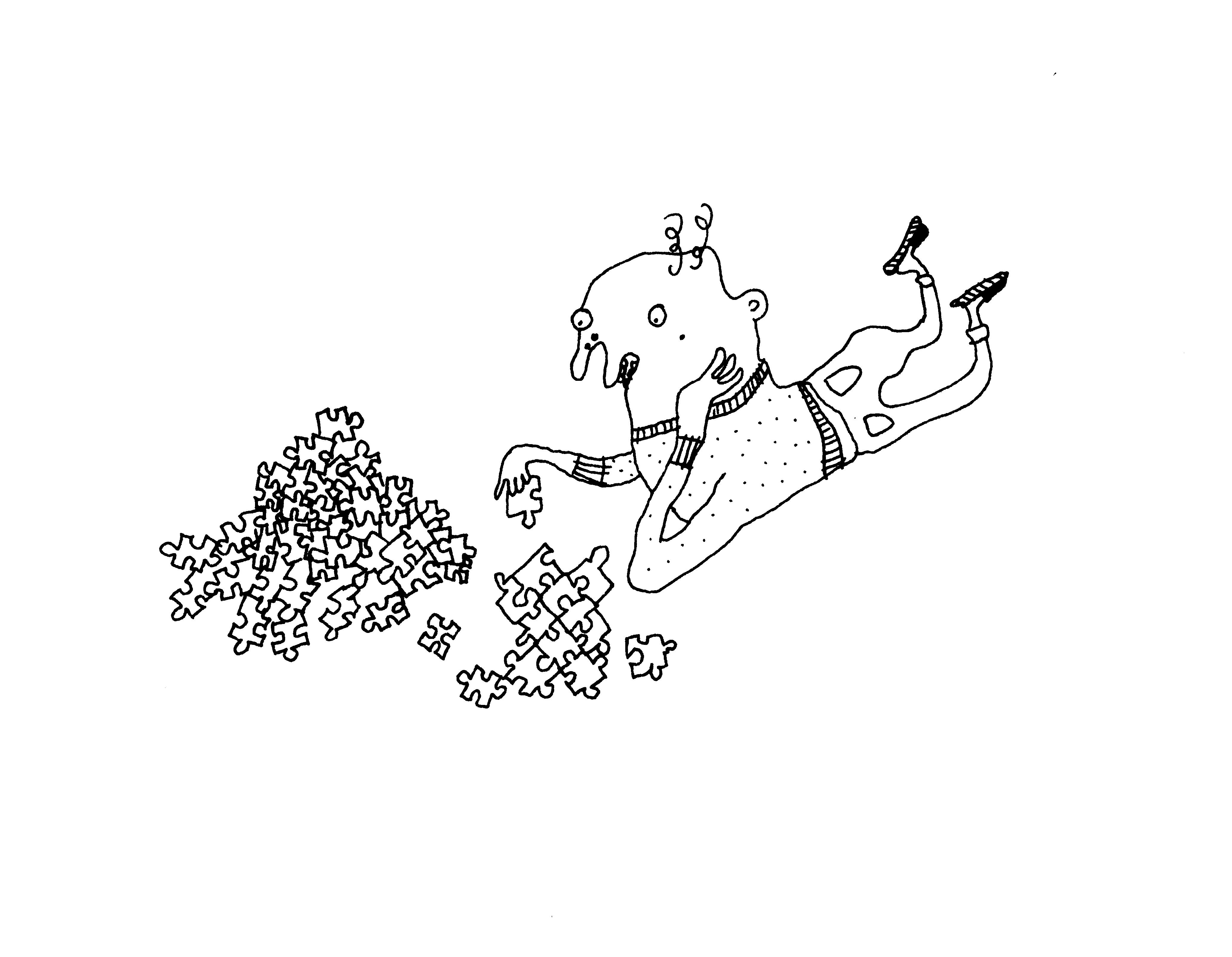Ein Junge spielt liegend mit einem Puzzle