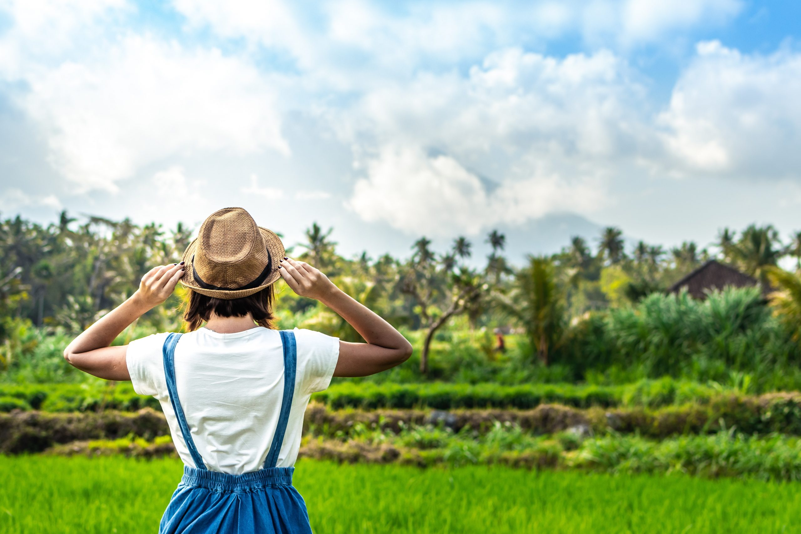 Woman standing in front of green field 2292949 scaled