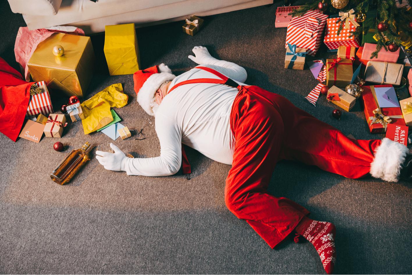 Kerstman vloer dronken