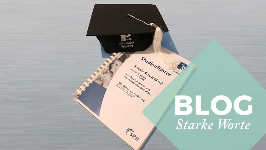 Starke Worte: Abschlusszeugnis und Diplomhut