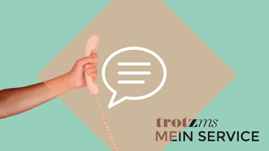 Hand mit Telefonhörer und Schriftzug