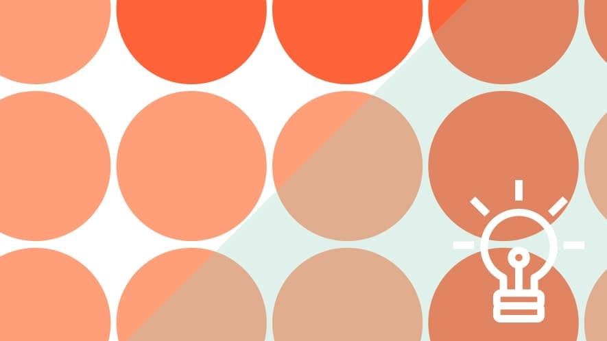 orangene Punkte und Glühbirne