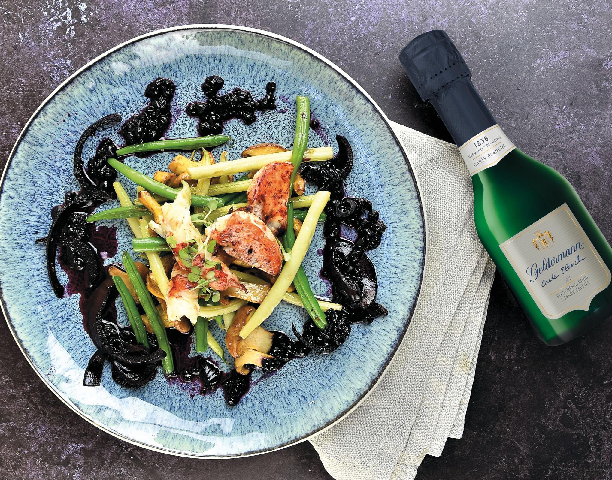 Confierter Hummer mit Pilz-Bohnen-Gemüse