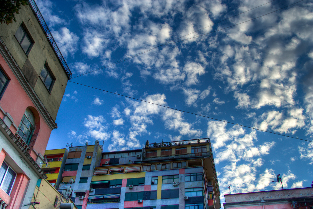 Image result for The bright colours of Tirana's apartment blocks are an eye-catching reminder of its regeneration