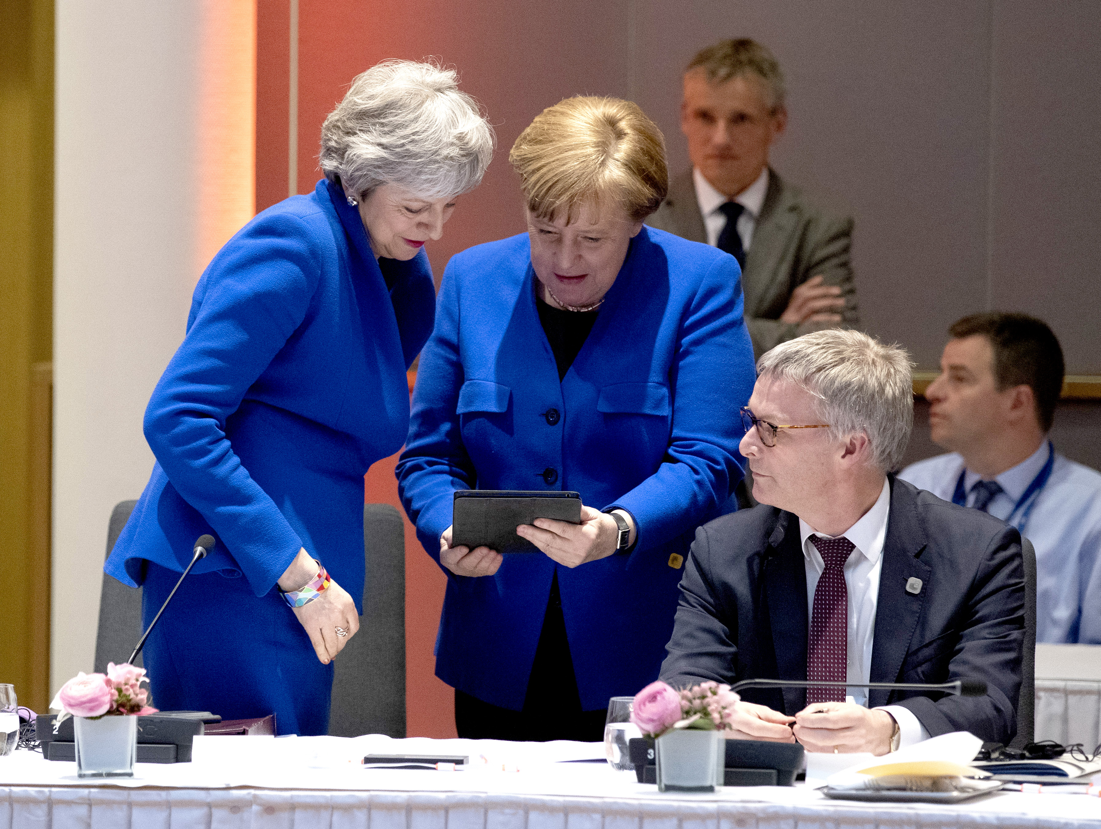 May and Merkel share a laugh over matching outfits