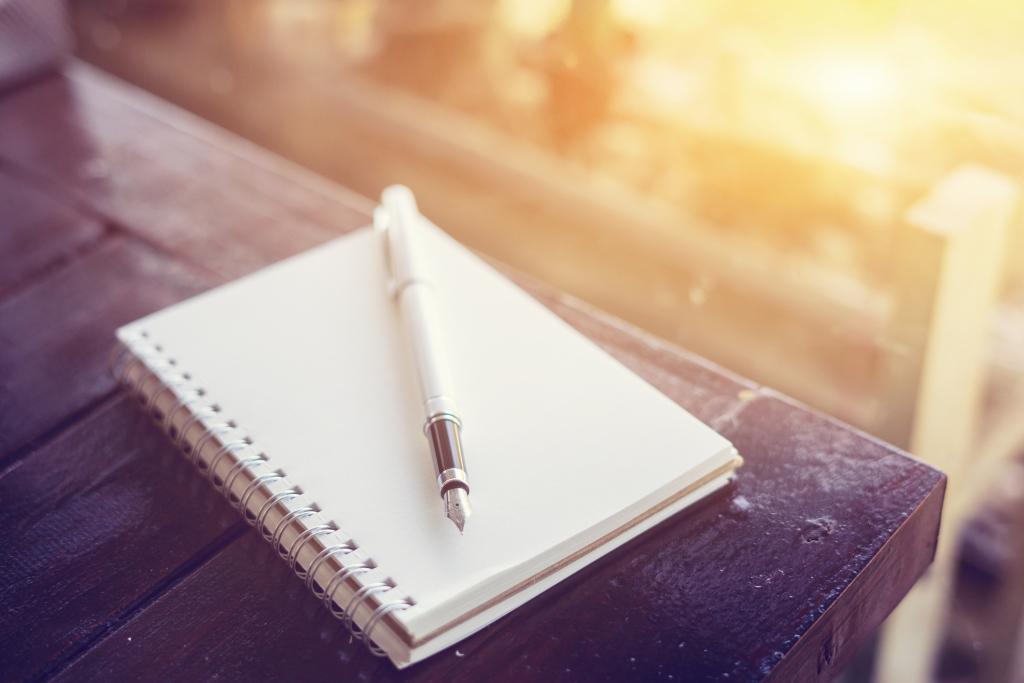 Notizblock mit Stift