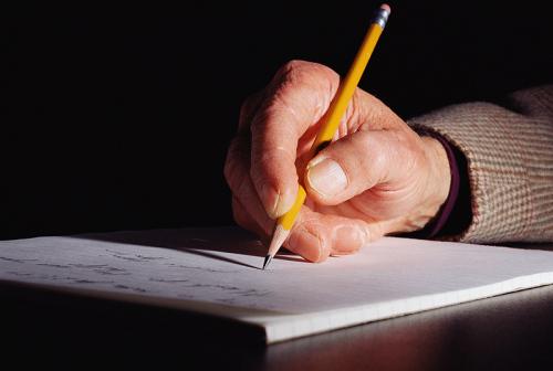 Schreibende Hand, Quelle photos.com