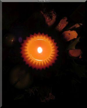 Brennende Kerze von oben gesehen