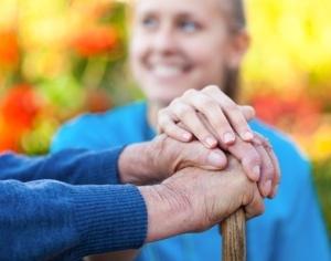 Junge Frau legt Hand auf Hände von älterer Person, © Barabas Attila - Fotolia