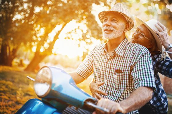 Paar auf Motorroller
