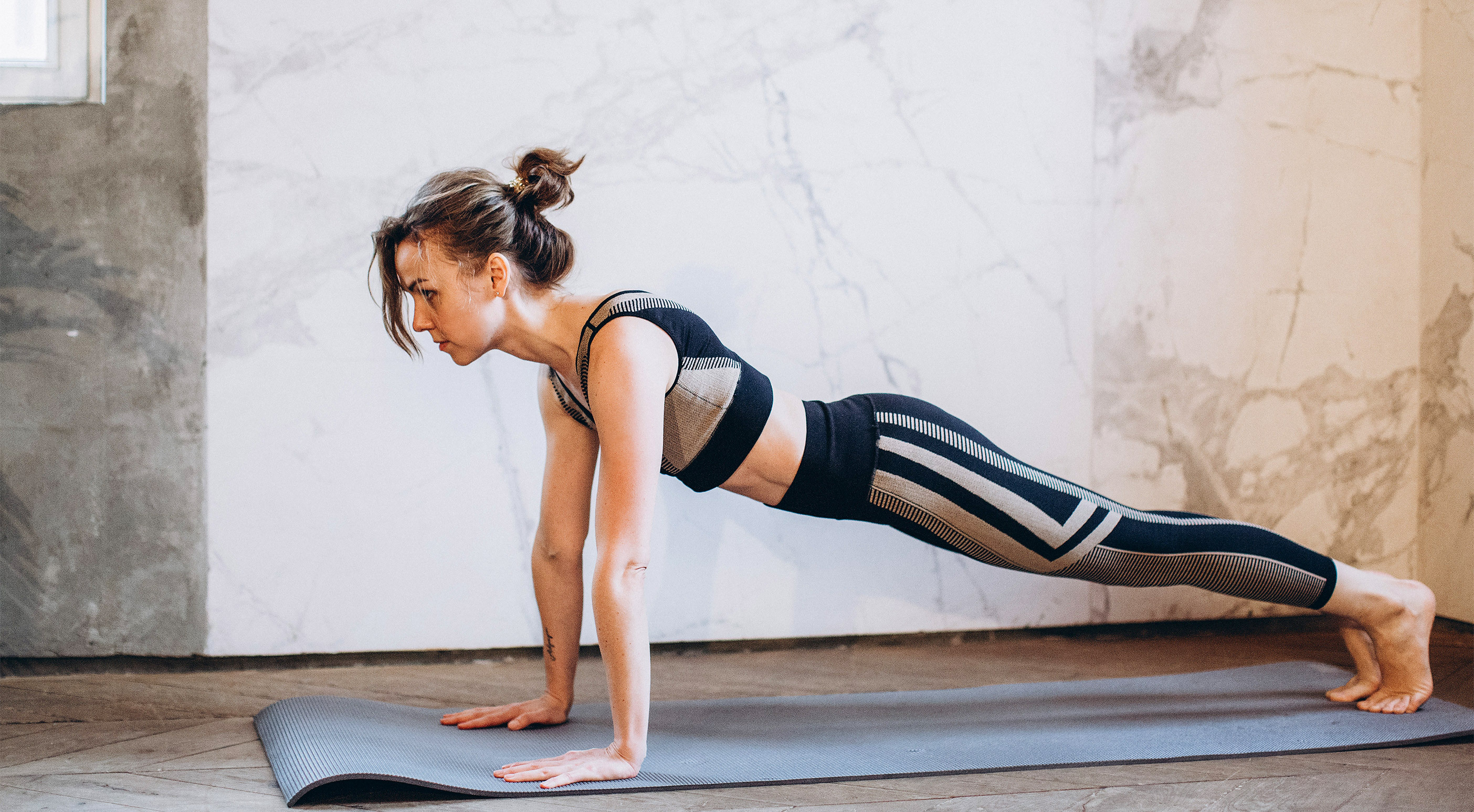 Woman doing plank as a core exercise
