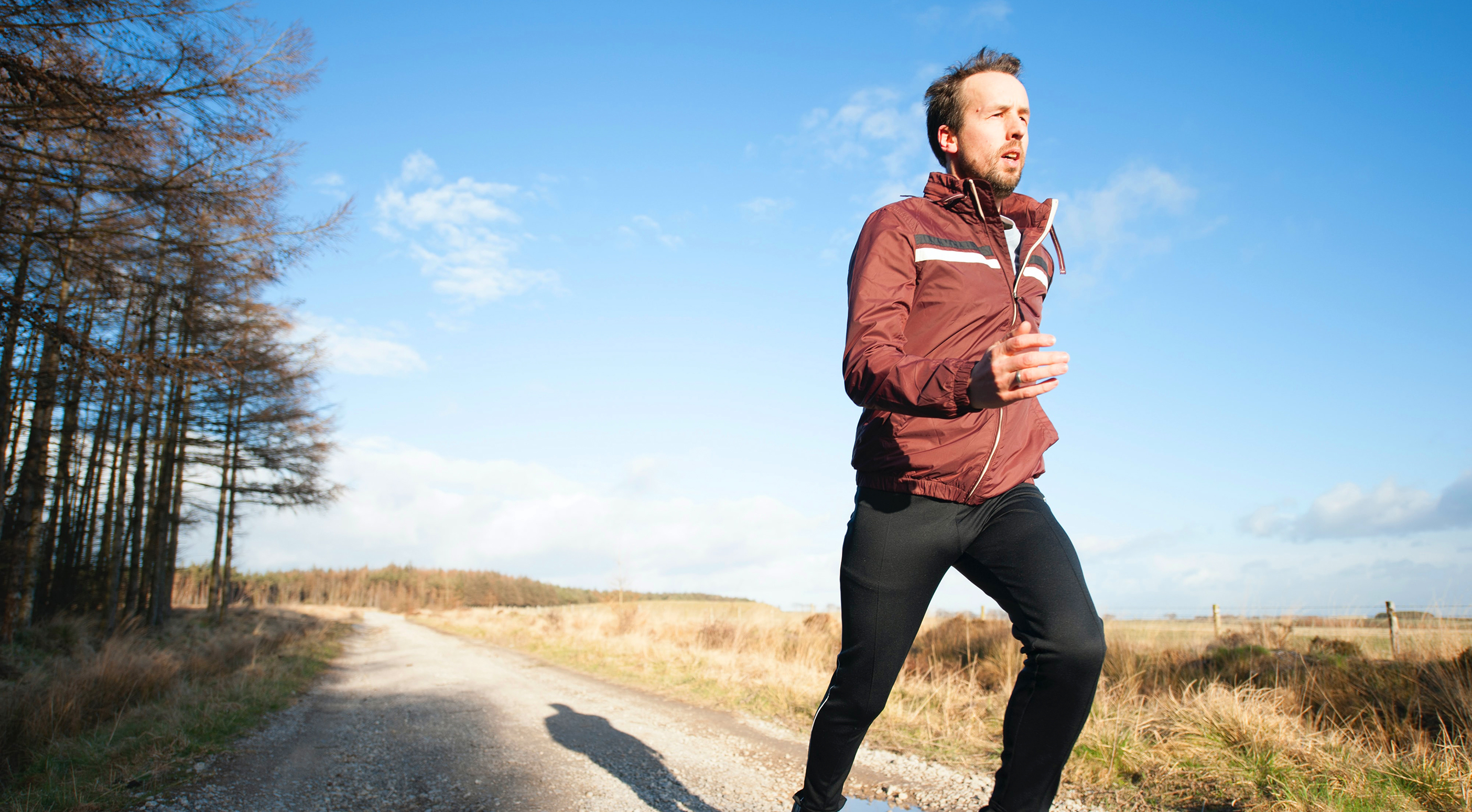 Man running outdoors, doing cardio exercise
