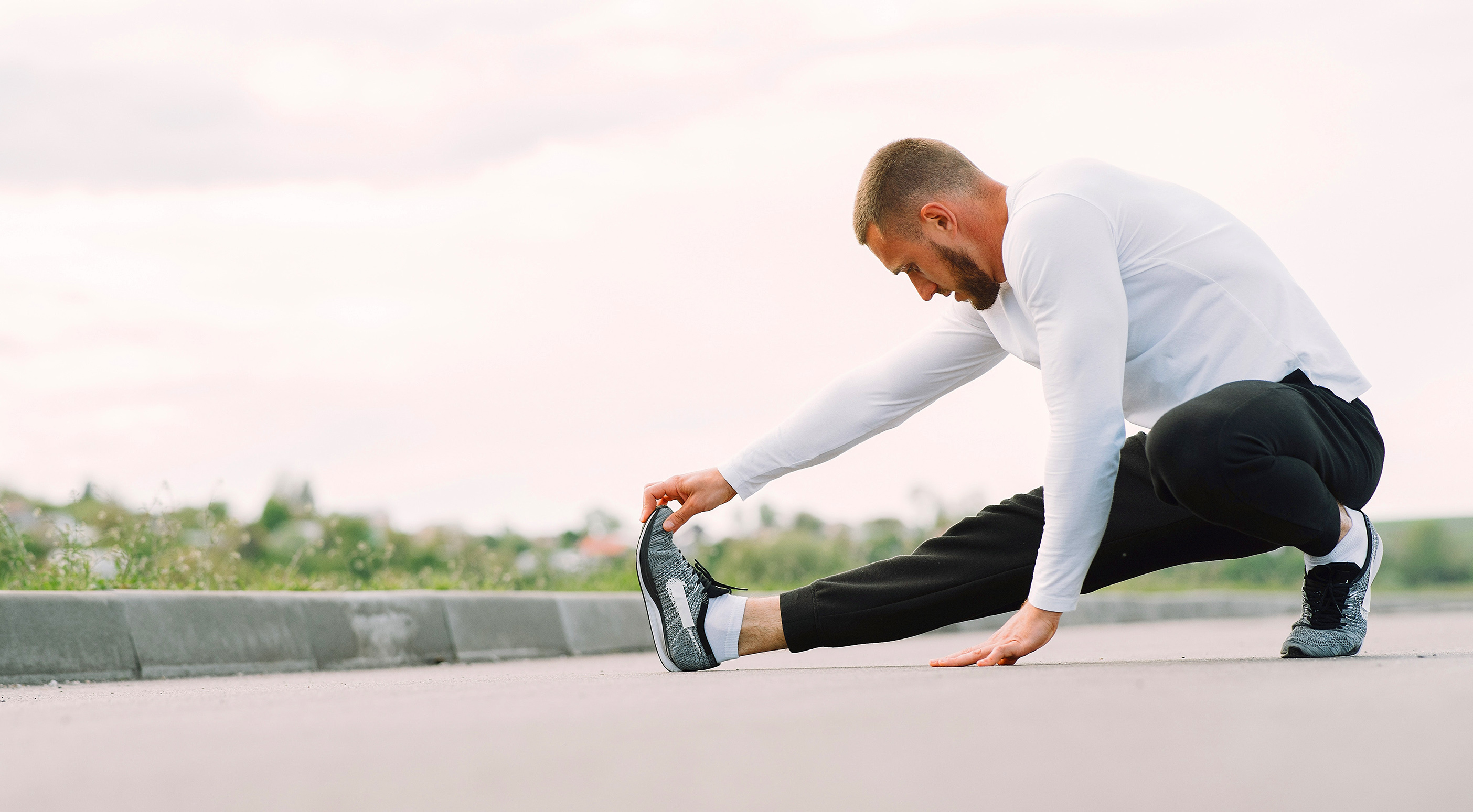 Young man exercising and stretching outside during ramadan