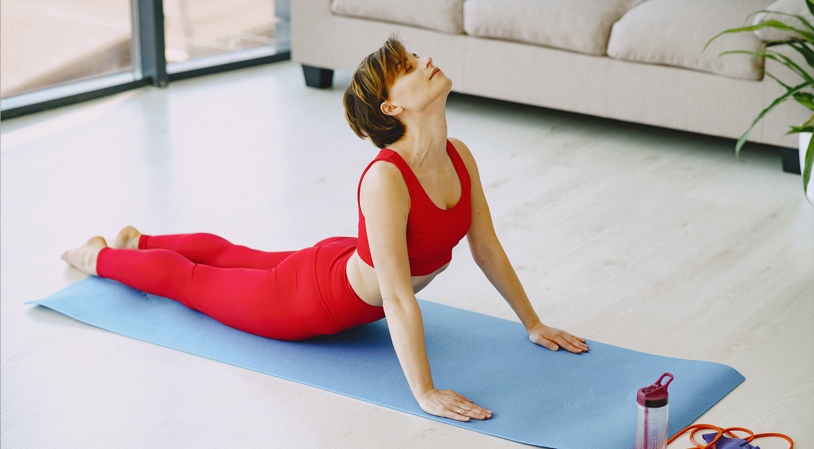 Woman breathing deeply while doing yoga