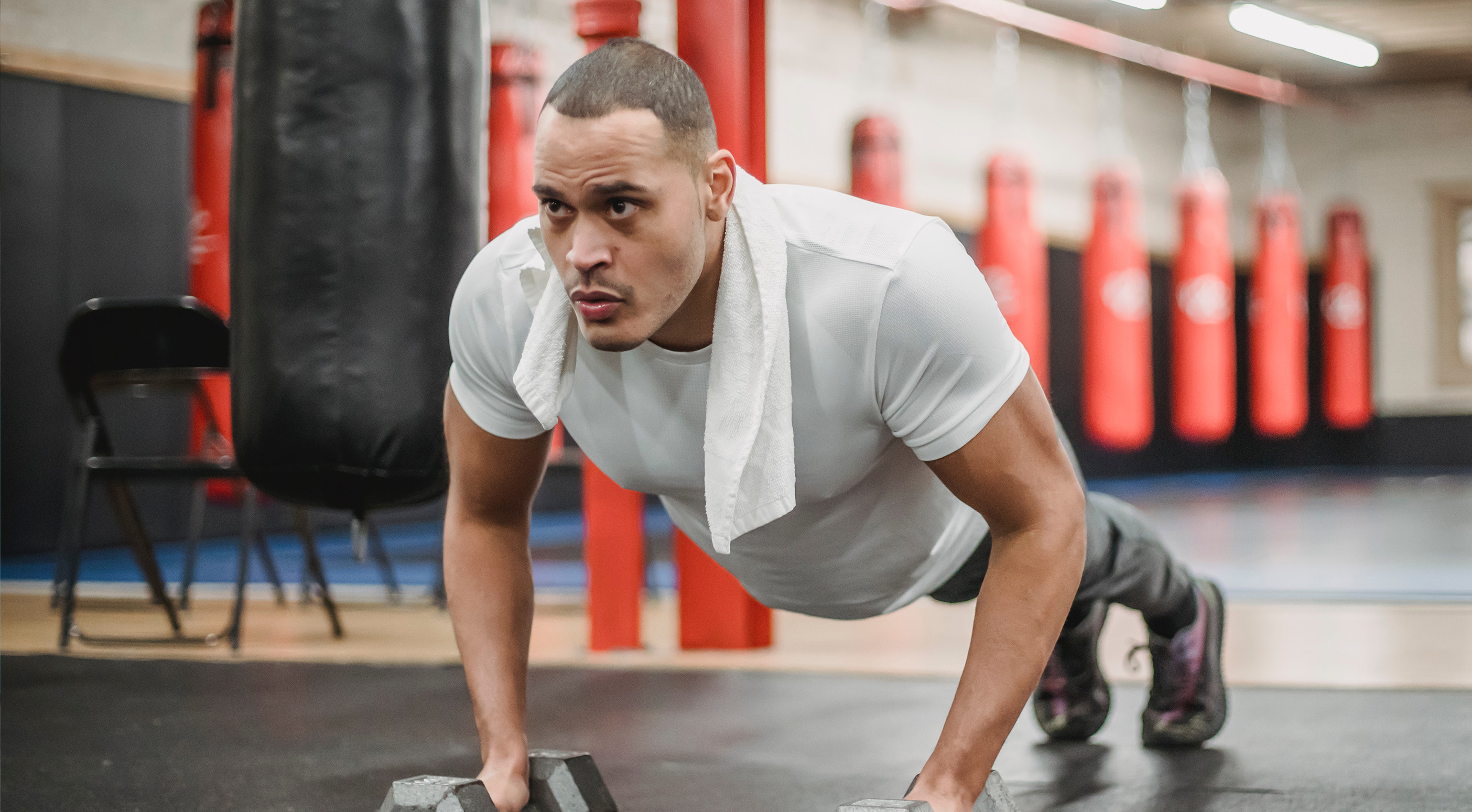 Man doing push ups in a gym