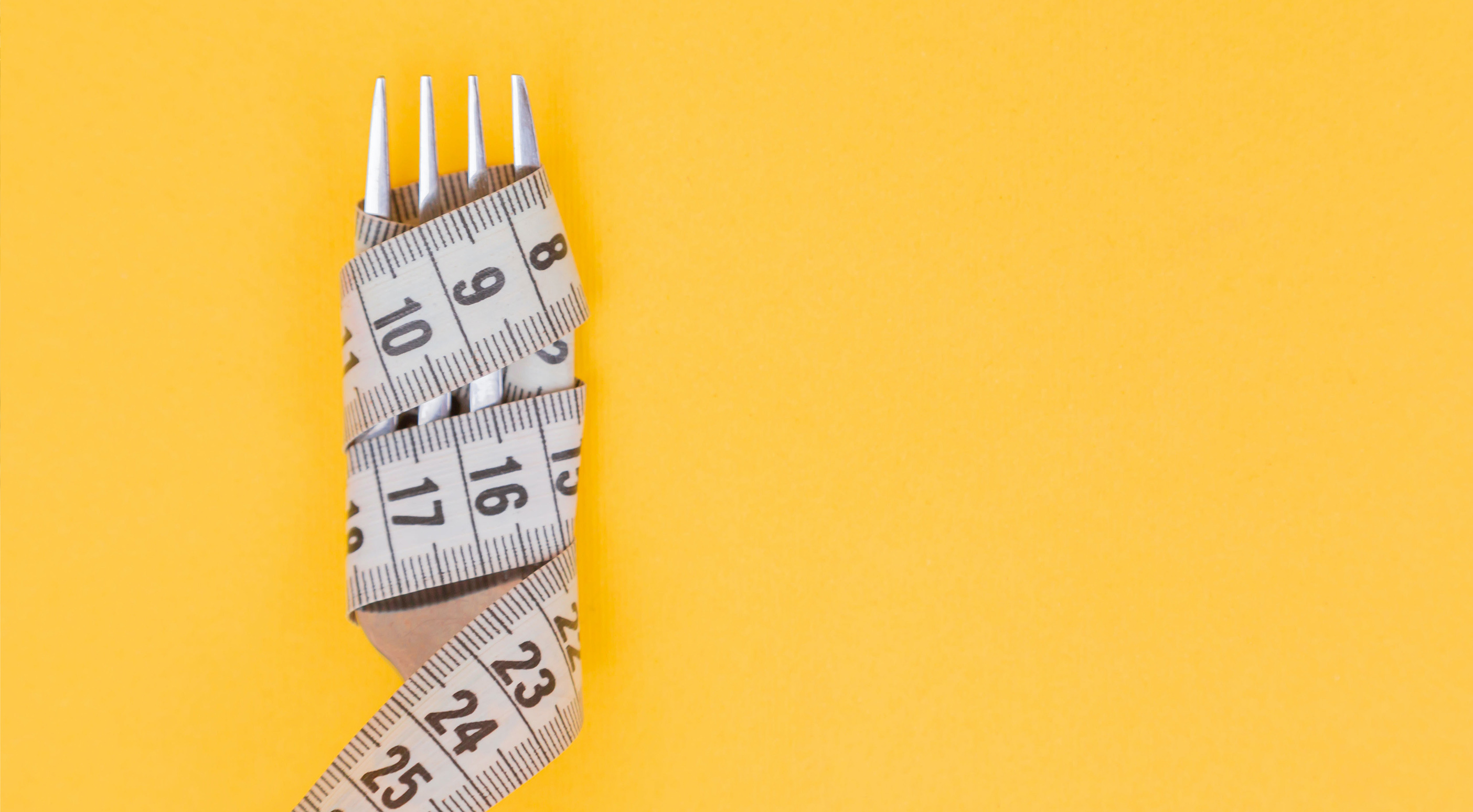 A fork covered by a tape measure